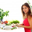 Stock Photo: Young womcooking healthly food