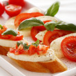 Bruschetta over white background — Stock Photo #7182016