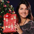 Happy woman with Christmas gift — Stock Photo