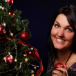 Woman are decorating the Christmas tree — Stock Photo