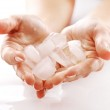 Hands with ice cubes — Stock Photo #7182329