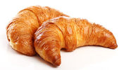 Croissant over white background — Stock Photo