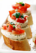Bruschetta over white background — Stock Photo