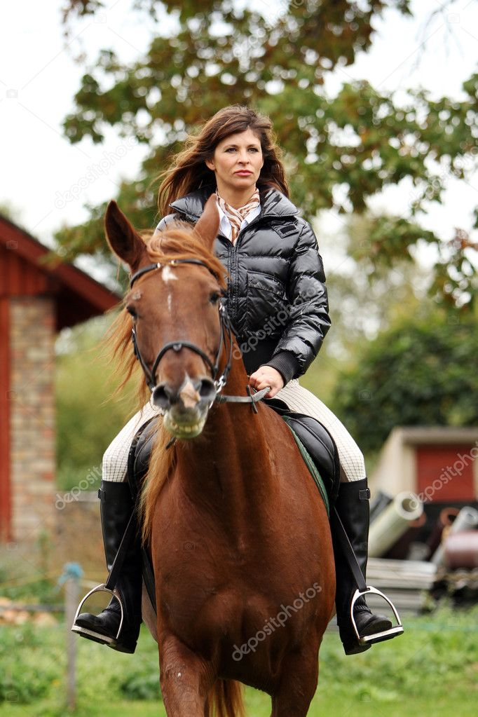 Woman and her beautiful  brown horse — Stock Photo #7182217
