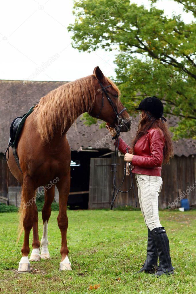 Woman and her beautiful  brown horse — Stock Photo #7182226