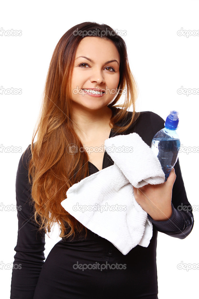 Beautiful smiling woman with  bottle of water and towel isolated over white — Stock Photo #7182351