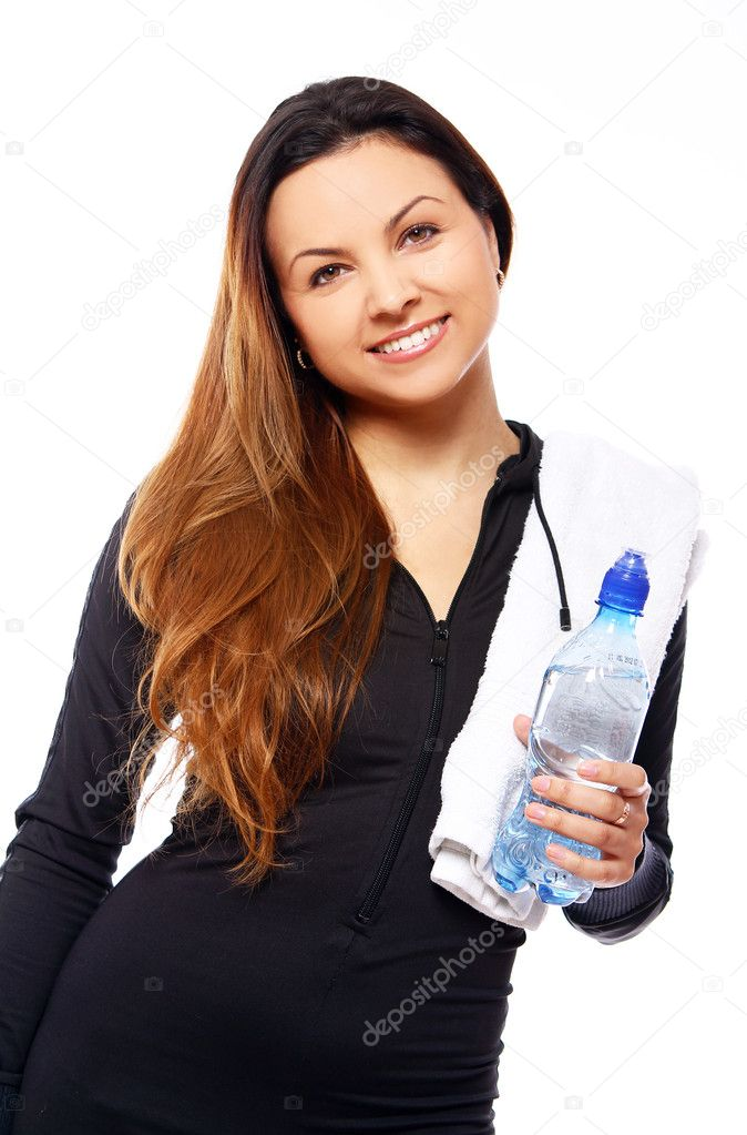 Beautiful smiling woman with  bottle of water and towel isolated over white  Stock Photo #7182352