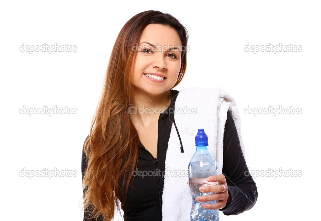 Beautiful smiling woman with  bottle of water and towel isolated over white — Stockfoto #7182353