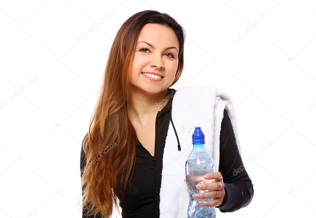 Beautiful smiling woman with  bottle of water and towel isolated over white — Stok fotoğraf #7182353