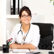 Royalty-Free Stock Photo: Young woman doctor in her office