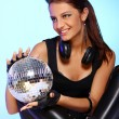 Beautiful girl with headphones and disco ball - Stock Photo