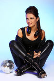 Beautiful girl with headphones and disco ball — Stock Photo