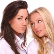 Two beautiful girls against white background — Stock Photo #7681330