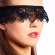 Woman with black lace mask over her face — Stock Photo #7681964