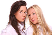 Two beautiful girls against white background — Stock Photo