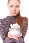 Youngl woman with a small gift box in hands — Stock Photo