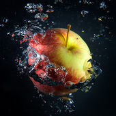 Apple is under water in a stream of air bubbles — Stock Photo