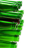 Beer bottles of green glass and a brown — Stock Photo