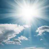 A blue sky with clouds and sun — Stock Photo