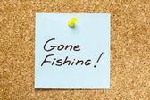 GONE FISHING! sticky note — Stock Photo