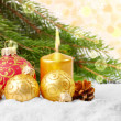 Christmas balls and gold candle — Stock Photo #7510299