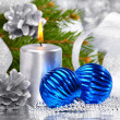 Blue christmas balls and silver candles — Stock Photo #7543447