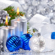 Blue christmas balls and silver candles — Stock Photo