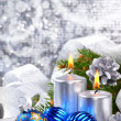 Blue christmas balls and silver candles — Stock Photo #7543477