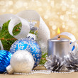 Blue and white christmas balls with silver candle — Stock Photo #7554441