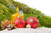 Christmas balls and gold candle — Stock Photo