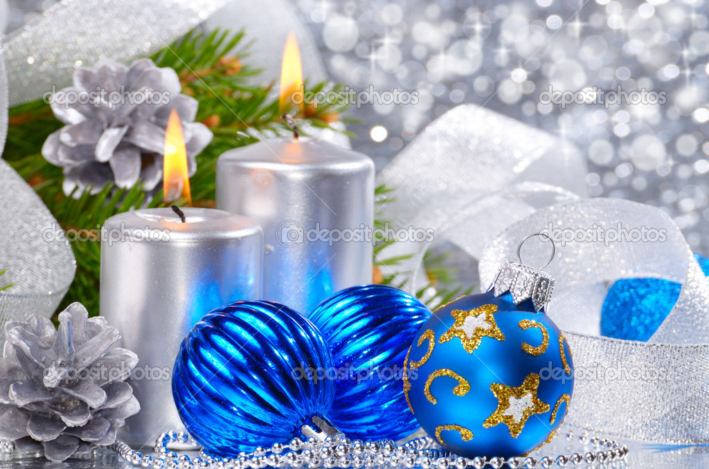 Blue Christmas balls with silver candles over bright background — Stock Photo #7603596
