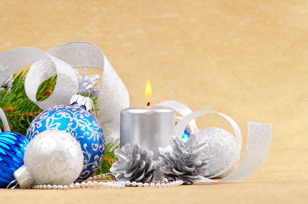 Blue Christmas balls with silver candle over bright background — Stock Photo #7603631