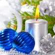Blue christmas balls and silver candle — Stock Photo #7627801
