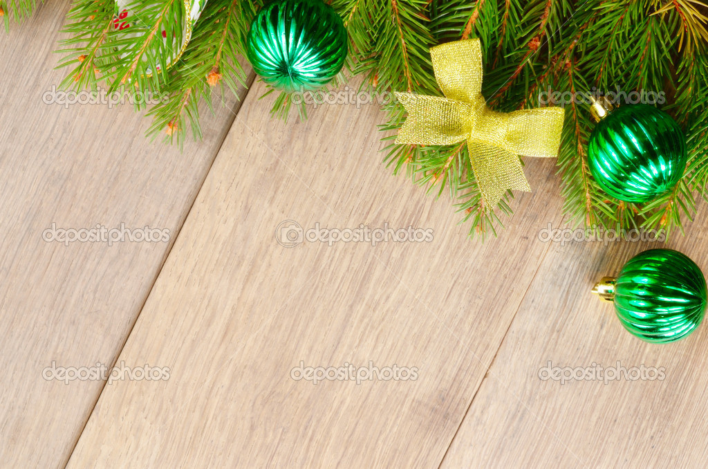 Christmas decoration border over wooden background — Stock Photo #7626044
