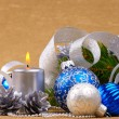 Blue and white christmas balls with silver candle - Stock Photo