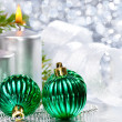 Christmas balls and silver candles — Stock Photo