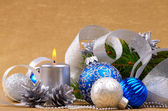 Blue and white christmas balls with silver candle — Stockfoto
