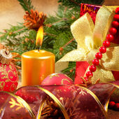 Gift box with christmas decorations — Stock Photo