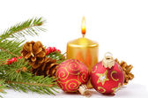 Christmas balls and golden candle — Stock Photo