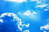 Dramatic blue sky with cumulus clouds — Stock Photo