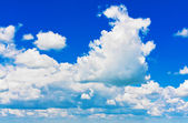 Blue sky with cumulus clouds — Stock Photo