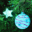 Bauble on firtree — Stock Photo