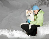 Winter portrait woman with dog — Stock Photo