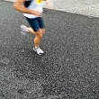 Man running in city marathon, motion blur — Stock Photo