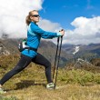 Stock Photo: Woman exercising in mountains