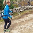 Stock Photo: Woman nordic walking on country trail