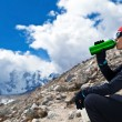 Woman drinking in mountains — Stock Photo #7375976