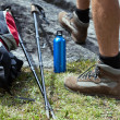 Hiker and hiking equipment — Stock Photo