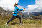 Woman exercising in mountains — Stock Photo