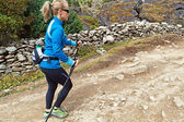 Woman nordic walking on country trail — Stock Photo